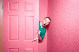 man-in-pink-room